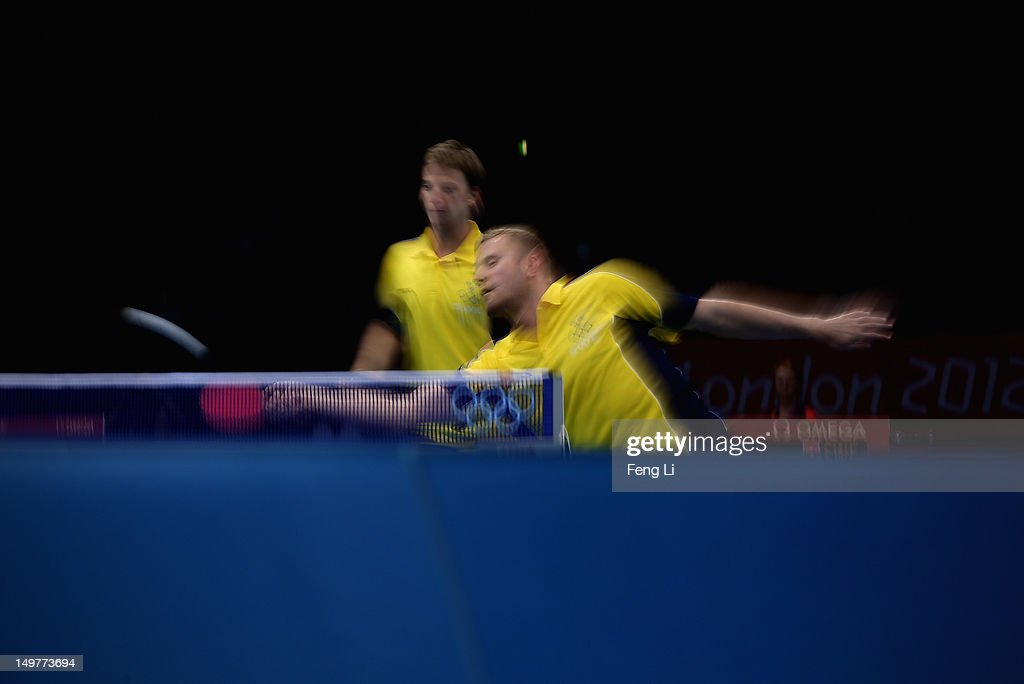 Par Gerell and Jens Lundqvist of Sweden complete during Men's Team Table Tennis first round match against team of Germany on Day 7 of the London 2012 Olympic Games at ExCeL on August 3, 2012 in London, England.