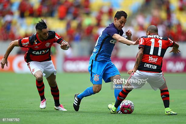 Para and Emerson of Flamengo struggle for the ball with Rodriguinho of Corinthians during a match between Flamengo and Corinthians as part of...