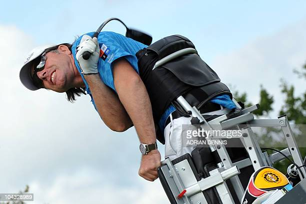 Para golfer Dirk Ulucle of Switzerland watches his drive as his club bows around his shoulder during the second day of the Disabled British Open golf...