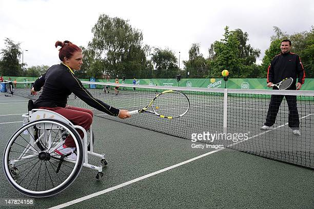 Para Olympian Jordanne Whiley and Roger Draper at the allplay tennis park event at Clapham Common on July 4 2012 in London England Today was the...