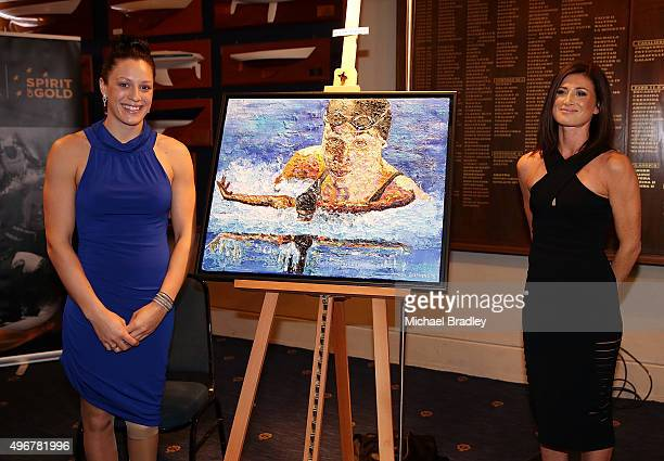 ParaAthelete Sophie Pascoe poses with her portrait painted by artist Amber Stephens during the Prime Ministers' Dinner presented by Paralympics New...
