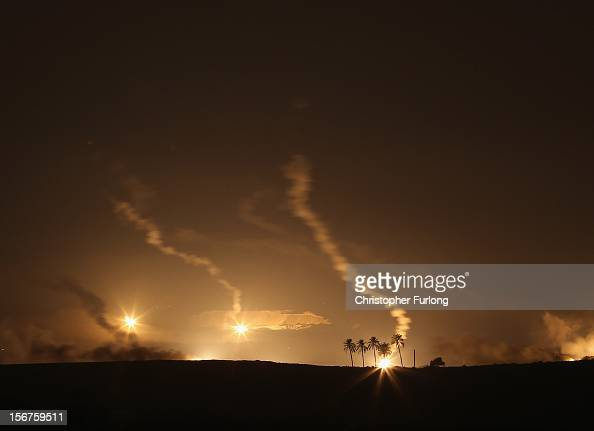 Parachute flares illuminate the Gaza Strip for an artillery barrage hours before a proposed cease fire on November 20 2012 on Israel's border with...