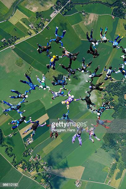 Parachute jumpers in the sky, Sweden.