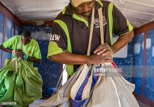 Parachute packers prepare skydiving equipment for new jumps at Swakopmund Namibia Well experienced workers have more than 20 thousand total pack jobs...