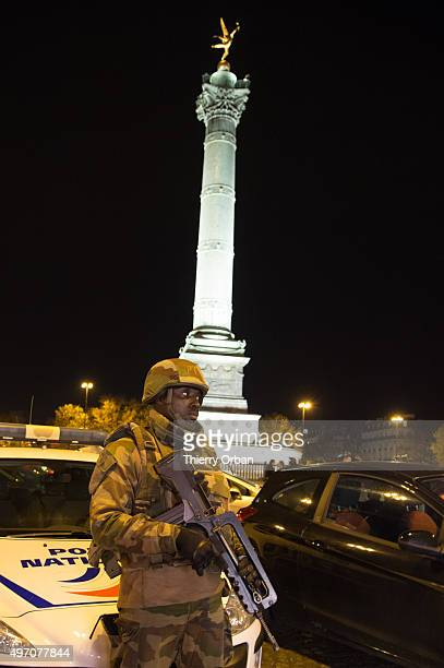Parachute troops patrol the streets on November 13 2015 in Paris France According to reports over 150 people were killed in a series of bombings and...