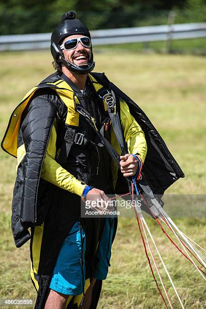 Parachuter after touch down in Bern Canton, Switzerland.