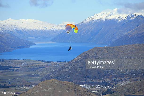 A parachuter is seen flying over Queenstown during the Winter Games NZ at Coronet Peak on August 25 2015 in Queenstown New Zealand