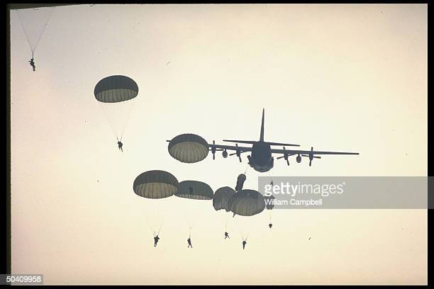 Parachutes dotting sky in US 18th Airborne jumping exercise from transport plane during training at Fort Bragg drop zone
