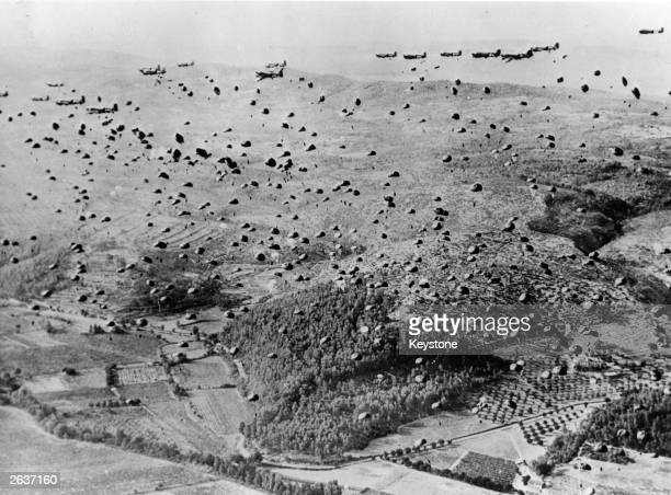 Parachutes fill the sky after the 12th Air Force Troop Carrier Air Division C47s drop Allied soldiers and supplies over the beachhead between...