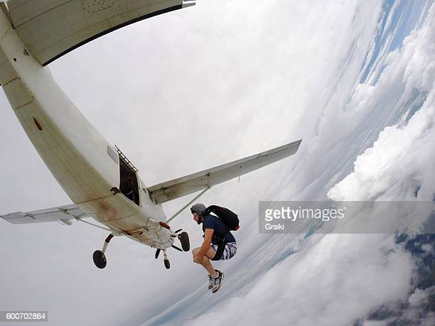 Parachutist leaving the plane with a back looping