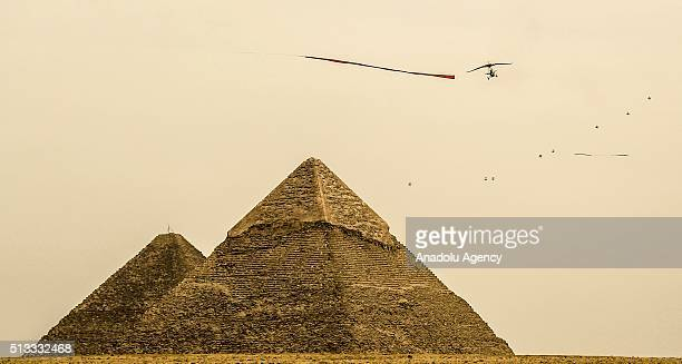 Parachutists glide on the sky over the Giza pyramid complex during 2nd Egyptian International Parachuting Championship organized with the attendance...