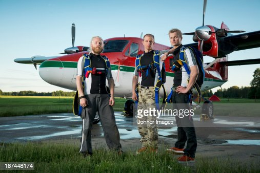 Parachutists in front of airplane : Stock Photo