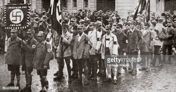 Parade by members of the SA Weimar Germany 1926 Founded in c1919 the Sturmabteilung was the paramilitary wing of the Nazi party Its members were...