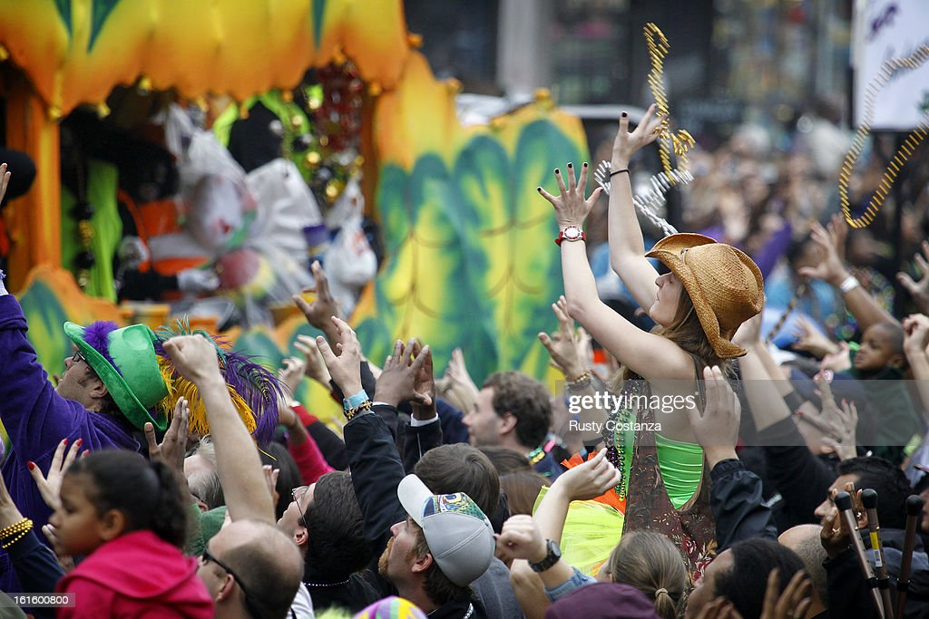 A parade goer catches a pair of beads tossed from a float in the Krewe of Zulu parade on Mardi Gras Day. Fat Tuesday, the traditional celebration on the day before Ash Wednesday and the begining of Lent, is marked in New Orleans with parades and marches through many neighborhoods in the city.