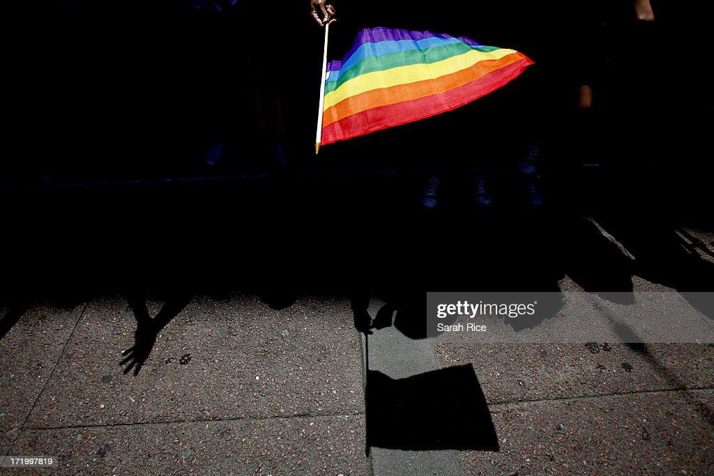 A parade goer waves a flag during 43rd annual San Francisco Lesbian Gay Bisexual Transgender Pride Celebration Parade June 30 in San Francisco...