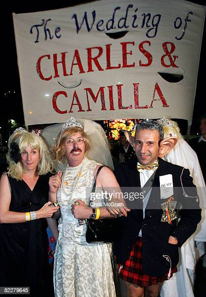 Parade Goers dressed as Prince Charles and Camilla pose for photographers during the Sydney New Gay and Lesbian Mardi Gras parade March 5 2005 in...