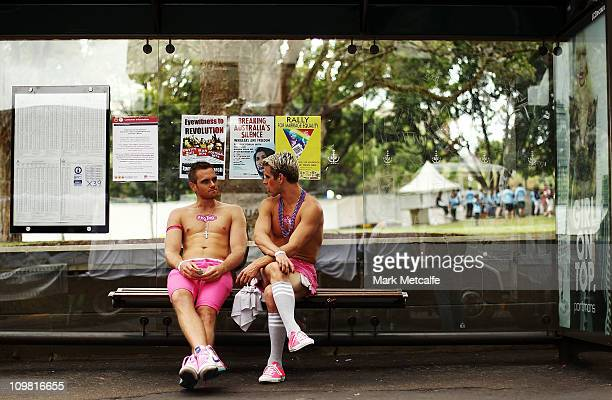 Parade goers talk at a bus stop prior to the start of the 2011 Sydney Gay Lesbian Mardi Gras Parade on March 5 2011 in Sydney Australia
