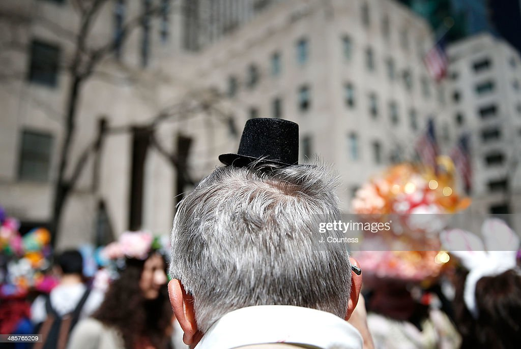 Parade goers wear creative hats and costumes on 5th Ave during the annual Easter Parade and Bonnet Festival on Easter Sunday on April 20, 2014 in New York City.