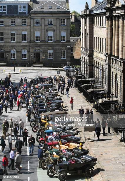 A Parade of 89 Ford Model T cars parade through Edinburgh to celebrate the centenary of the classic car