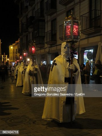 Parade Of Penitente People At City Street