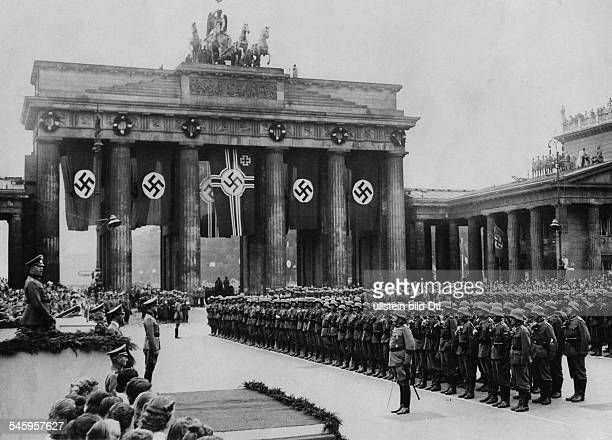 Parade of the Wehrmacht in Berlin in 1940 General Fritz Fromm speaking to the soldiers in front of the Brandenburg Gate next to the platform are...