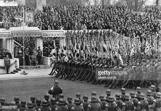 Parade of the Wehrmacht on Hitler's 50th birthday on the OstWestAchse in Berlin view of the VIP box behind Hitler fr the l Hermann Göring Erich...