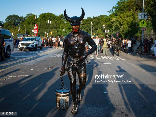 A parade participant covered in grease marches at the annual J'Ouvert Parade held in Crown Heights Brooklyn on Monday September 4 2017 The predawn...
