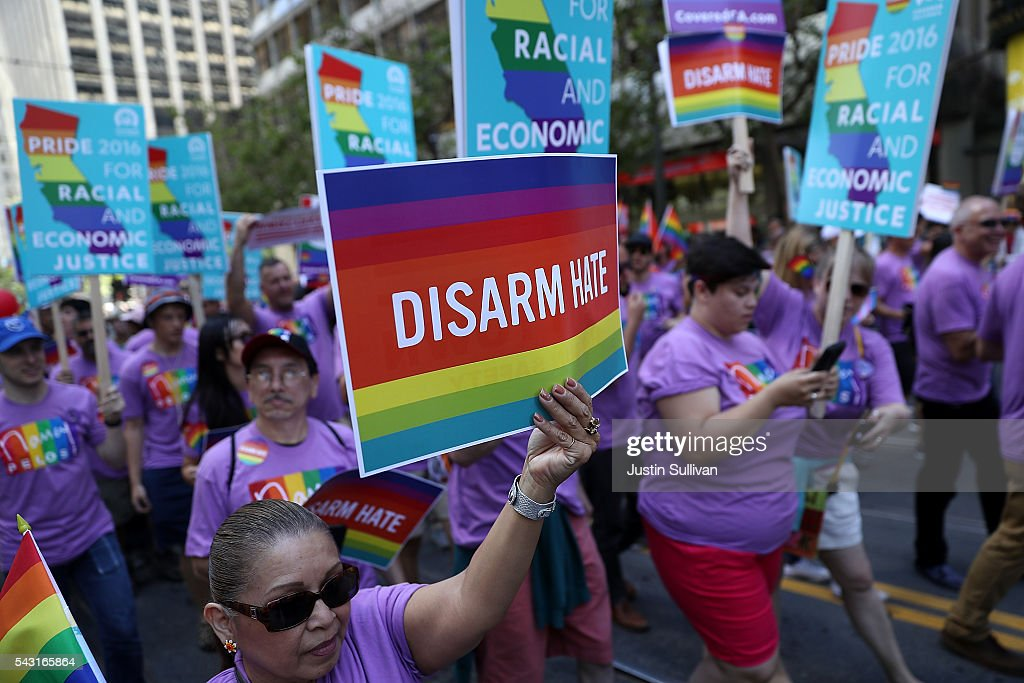 Parade participants hold signs as they march during the 2016 San Francisco Pride Parade on June 26, 2016 in San Francisco, California. Hundreds of thousands of people came out to watch the annual San Francisco Pride parade, one of the largest in the world.