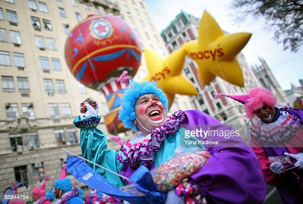 Parade participants throw confetti at the audience in front of the Macy's float at the annual Macy's Thanksgiving Day Parade on November 27 2008 in...