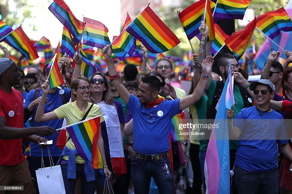 Parade participants wave pride flags as the march during the 2016 San Francisco Pride Parade on June 26, 2016 in San Francisco, California. Hundreds of thousands of people came out to watch the annual San Francisco Pride parade, one of the largest in the world.