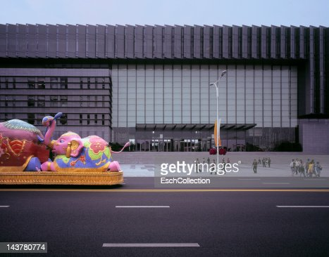 Parade vehicle passing Expo Center in Shanghai