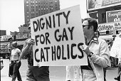 Paradegoers hold up a sign that reads 'Dignity for Gay Catholics' during the fifth annual Gay Pride Day March on 7th Avenue New York New York June 30...