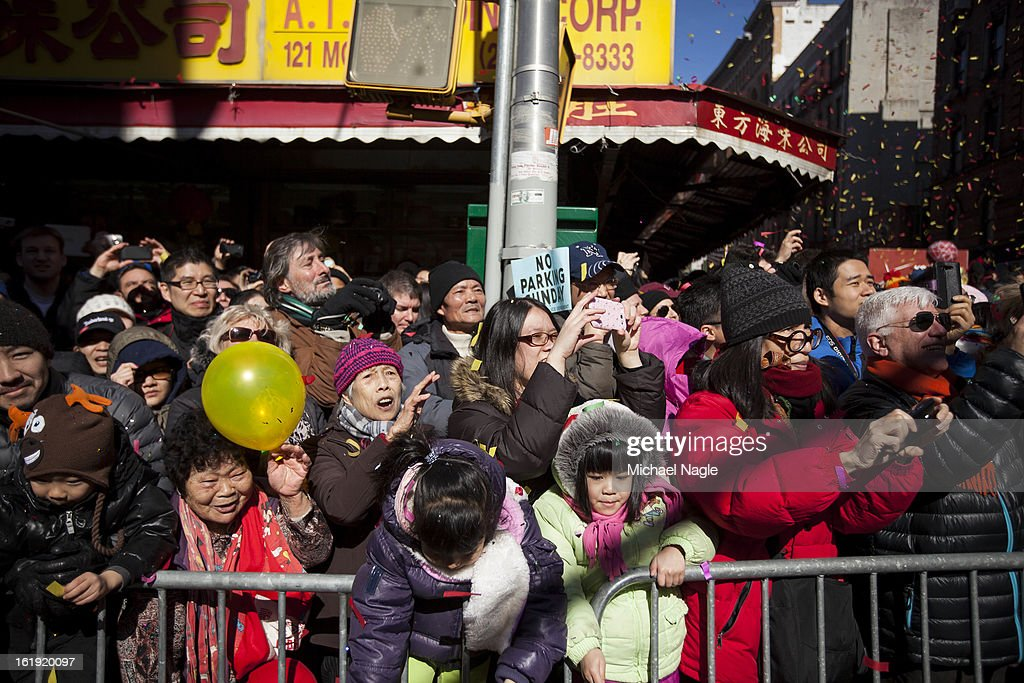 Parade-goers line the streets to watch the 14th Annual Chinatown Lunar New Year Parade on February 17, 2013 in New York City. This year celebrates the Year of the Snake.