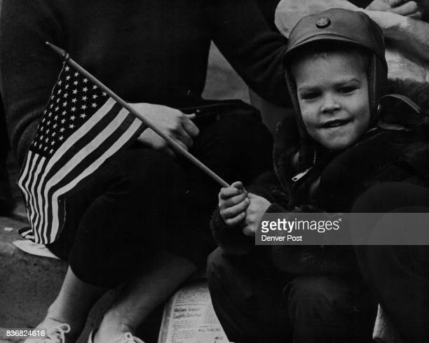 Parades Veterans Day flat drawer Dusty Betz son of Mr and Mrs Ronald C Betz 17 S Julian St had a front row seat and a American flag to show his...