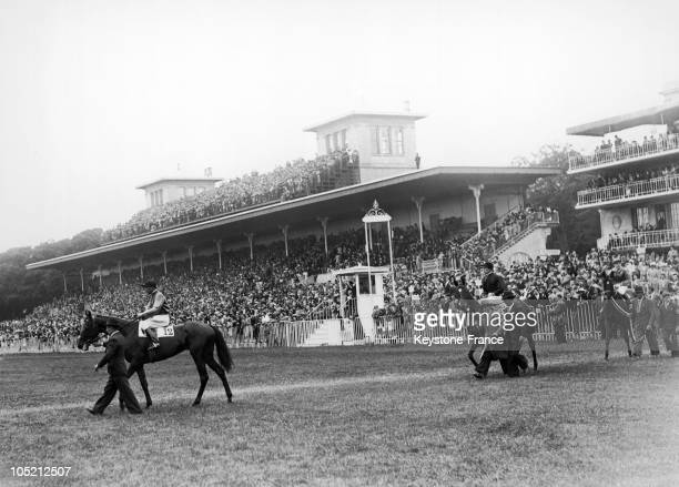 Parading The Horses In Front Of The Public Before The Depart Of The Prix De Diane At The Chantilly Racecourse