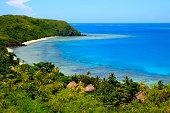 Paradise: aerial Fiji Yasawa islands view, deserted turquoise beach and bungalow palapas.
