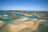 Aerial photo of the Noosa river which is one of the most pristine rivers in Australia. Clearly visible here are all the channels and sandbanks, with the town in the background.