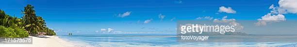 Paradise beach idyllic tropical island lagoon palm trees super panorama