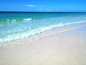 A crystal blue ocean with pristine sand.