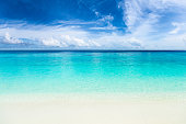 white sand beach with turquoise blue water