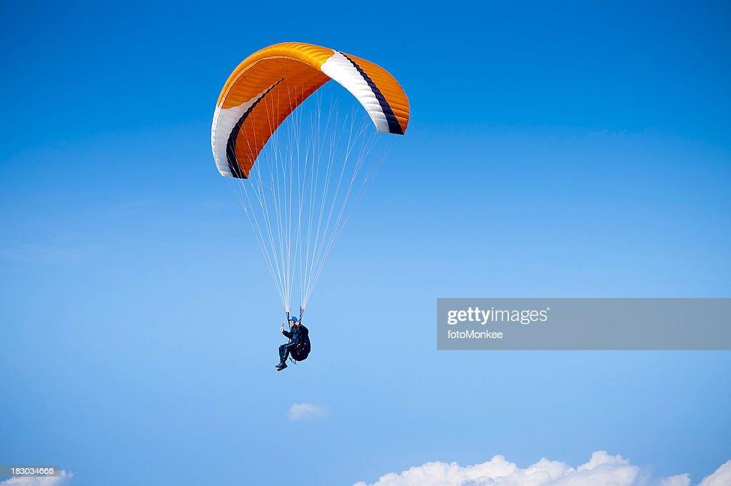 'Paraglider, airborne against big blue sky, UK'