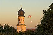 Paraglider and church steeple, Jakobsberg, Upper Bavaria, Bavaria, Germany