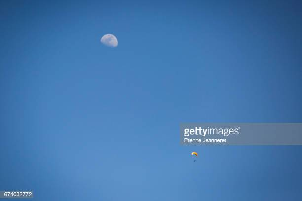 Paraglider and moon in blue sky, Maroc, 2017