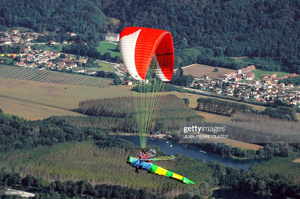 A paraglider competes on his 'dragonfly', on September 22, 2012 in Saint-Hilaire-du-Touvet, southeastern France, during the 39th edition of the Icare cup which runs until September 23. AFP PHOTO / Jean Pierre Clatot