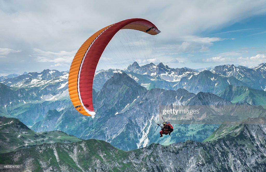 Paraglider flies from Nebelhorn over the 'Allgaeu Alps' on June 27 2015 in Oberstdorf Germany