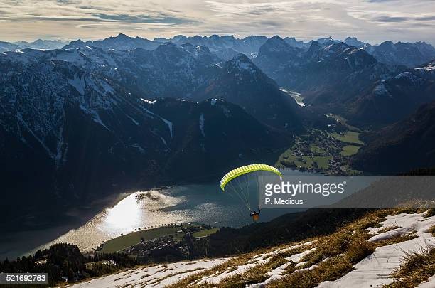 Paraglider flying above Achensee, Rofan mountains