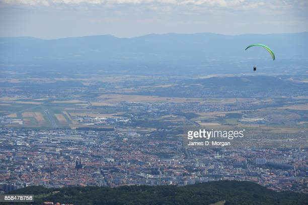 Paraglider in the sky over country town in France in July 17th 2017