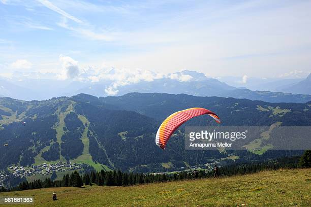 Paraglider over the French Alps in summer