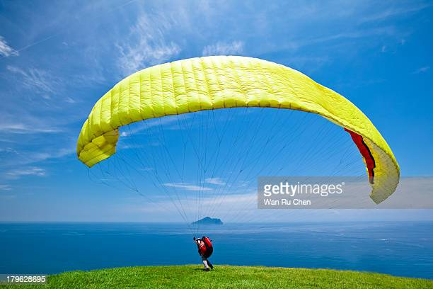 Paraglider taking off from a mountain