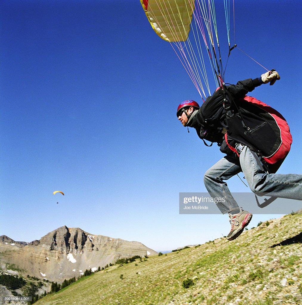 Paraglider taking off,  Jackson Hole, Wyoming, USA